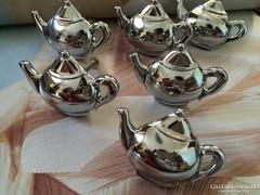 Csodálatos teáskanna fémműves bútor fogantyúk