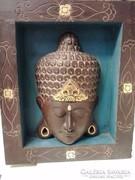 Faragott Buddha fej kerettel