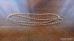 120 cm hosszú csiszolt borostyán színű gyöngysor