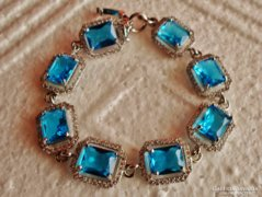 Kék topáz köves szép ezüstözött karkötő