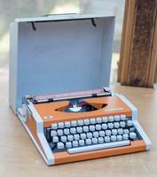 Narancssárga retro szalagos írógép UNIS tbm de Luxe