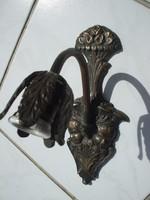 Emberfejes bronz falikar lámpa